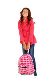 School girl child trying to lift heavy backpack Stock Image