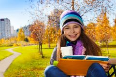 School girl with coffee and textbook Stock Images