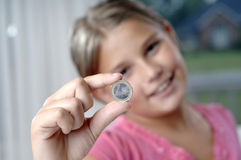 School girl and coins Stock Images