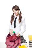 School girl collecting books into backpack Stock Images