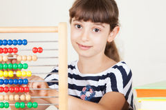 School Girl With Colourful Books And Abacus. Preschool Portrait Royalty Free Stock Photos