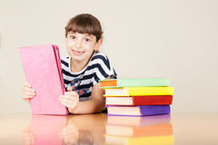 School Girl With Colourful Books And Tablet. Preschool Portrait Stock Photos