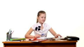 School girl doing her homework thinking about the stock footage