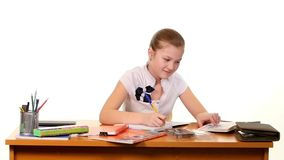 School girl doing her homework thinking about the stock video footage