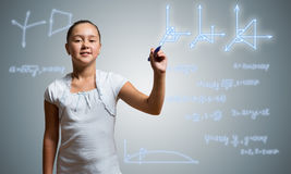 School girl draw on screen. Cute little girl drawing science sketches on screen stock images