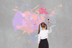 School girl drawning. On the blackboard Stock Photos