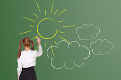 School girl drawning. Sun on the blackboard Royalty Free Stock Image