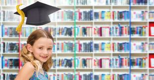 School girl in education library with graduation hat. Digital composite of School girl in education library with graduation hat stock photo