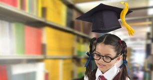 School girl in education library with graduation hat. Digital composite of School girl in education library with graduation hat stock images