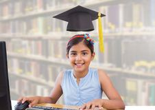 School girl in education library with graduation hat. Digital composite of School girl in education library with graduation hat royalty free stock photos