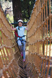 School girl enjoying activity in a climbing adventure park Royalty Free Stock Photography