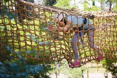 School girl enjoying activity in a climbing adventure park Royalty Free Stock Image