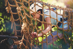 School girl enjoying activity in a climbing adventure park Stock Photo