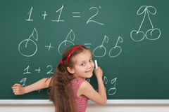 School girl exercise math on board Royalty Free Stock Image