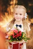 School girl with flowers royalty free stock photo
