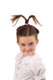 School girl with funny hair style 5. School girl with funny hair style smiling at the camera Stock Photos
