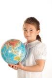 School girl with a globe stock photos