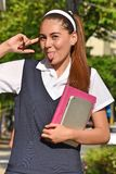 School Girl And Happiness Wearing School Uniform With Books