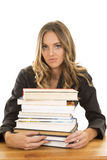 School girl hold stack of books serious Royalty Free Stock Images