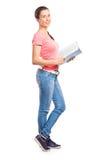 School girl holding a book Stock Photos