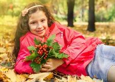 School girl holding bouquet of orange ashberries Stock Photo