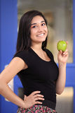 School Girl Holding a Green Apple Stock Photography