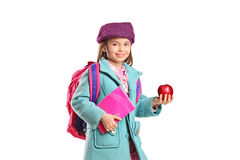 School girl holding notebook and apple Stock Photo