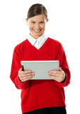 School girl holding tablet computer Stock Image