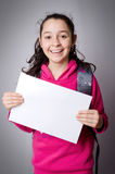 School girl holding up a blank sign Royalty Free Stock Photo