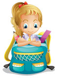 A school girl inside a schoolbag Royalty Free Stock Photos