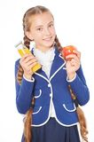 School girl with juice and apple Stock Images