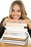 School girl lean on books smile Royalty Free Stock Photo