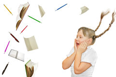School girl looking surpised at school objects. Flying Royalty Free Stock Images