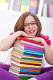 School girl with lots of books Stock Images