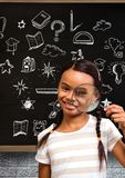 School girl with magnifying glass and Education drawing on blackboard for school. Digital composite of School girl with magnifying glass and Education drawing on stock images