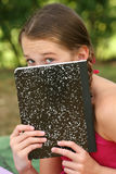 School GIrl With a Notebook Outdoors Stock Photos