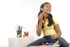 School girl painting cheek Royalty Free Stock Image