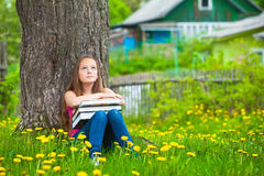 School girl in the park with books Royalty Free Stock Photo