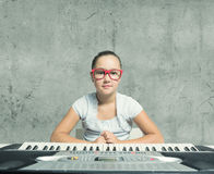 School girl with piano Royalty Free Stock Photo
