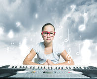 School girl with piano Stock Image