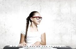 School girl with piano Stock Photo