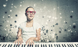 School girl with piano Royalty Free Stock Photography