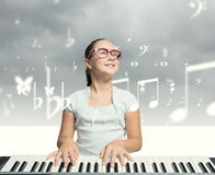 School girl with piano Stock Photos