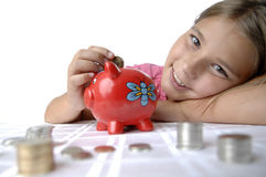 School girl and piggy bank Stock Images