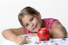 School girl and piggy bank Stock Photos