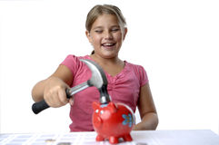 School girl and piggy bank Royalty Free Stock Photo