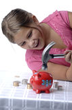 School girl and piggy bank Royalty Free Stock Images