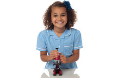 School girl playing with microscope Royalty Free Stock Photo
