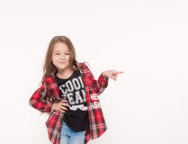 School girl pointing with finger away isolated on white. Child school girl pointing with finger away isolated on white. Education school study concept Stock Photo