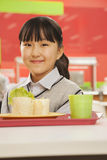 School girl portrait in school cafeteria Stock Photo